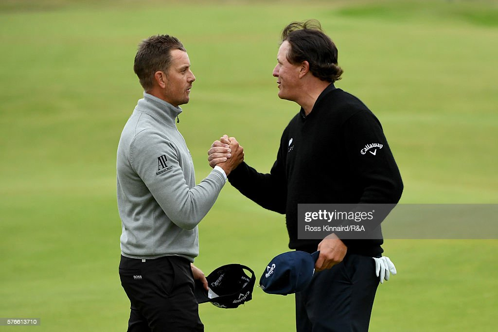 Phil Mickelson of the United States shakes hands with Henrik Stenson of Sweden (L) on the 18th green during the third round on day three of the 145th Open Championship at Royal Troon on July 16, 2016 in Troon, Scotland.