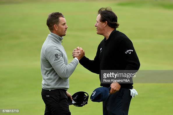 Phil Mickelson of the United States shakes hands with Henrik Stenson of Sweden on the 18th green during the third round on day three of the 145th...