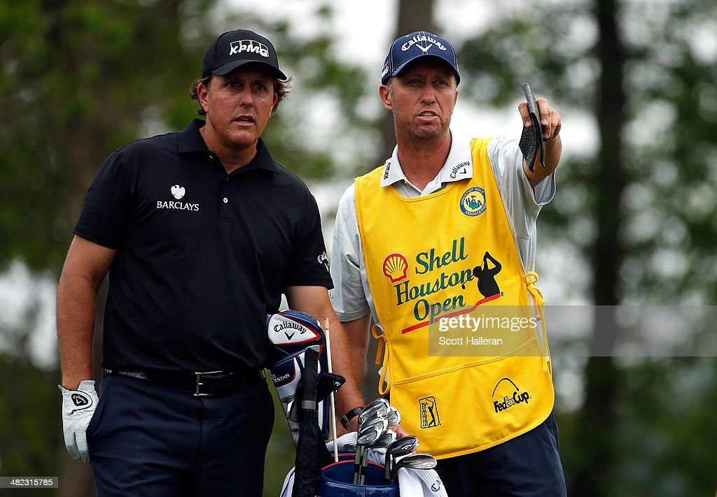 <a gi-track='captionPersonalityLinkClicked' href=/galleries/search?phrase=Phil+Mickelson&family=editorial&specificpeople=157543 ng-click='$event.stopPropagation()'>Phil Mickelson</a> of the United States talks with his caddy Jim Mackay during round one of the Shell Houston Open at the Golf Club of Houston on April 3, 2014 in Humble, Texas.