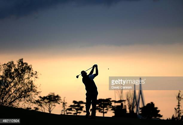 Phil Mickelson of the United States team plays his second shot on the 15th fairway as the sun sets during the Saturday afternoon fourball matches at...