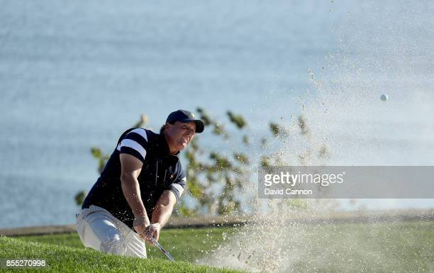 Phil Mickelson of the United States team plays his third shot on teh 14th hole in his match with Kevin Kisner agianst Jason Day and MArc Leishman of...