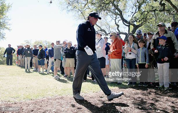 Phil Mickelson of the United States waits to play a shot near the practice range on the sixth hole during the second round of the World Golf...