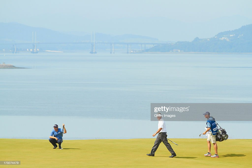 <a gi-track='captionPersonalityLinkClicked' href=/galleries/search?phrase=Phil+Mickelson&family=editorial&specificpeople=157543 ng-click='$event.stopPropagation()'>Phil Mickelson</a> of the United States walks across a green during the first round of the Aberdeen Asset Management Scottish Open at Castle Stuart Golf Links on July 11, 2013 in Inverness, Scotland.