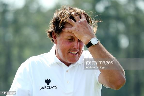 Phil Mickelson of the United States walks off the 18th green after completing the second round of the 2014 Masters Tournament at Augusta National...
