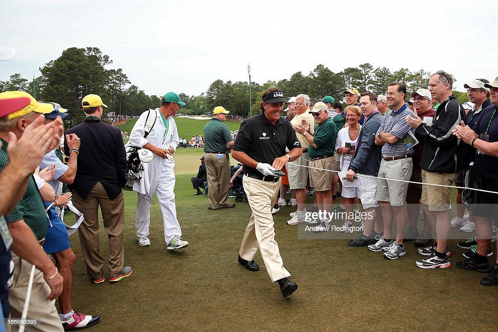 Phil Mickelson of the United States walks through as patrons clap during the final round of the 2013 Masters Tournament at Augusta National Golf Club on April 14, 2013 in Augusta, Georgia.