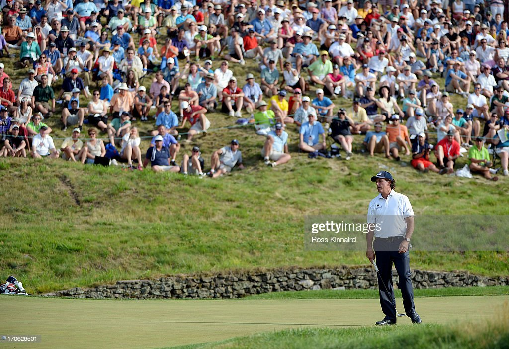 Phil Mickelson of the United States watches his putt on the ninth hole during Round Three of the 113th U.S. Open at Merion Golf Club on June 15, 2013 in Ardmore, Pennsylvania.