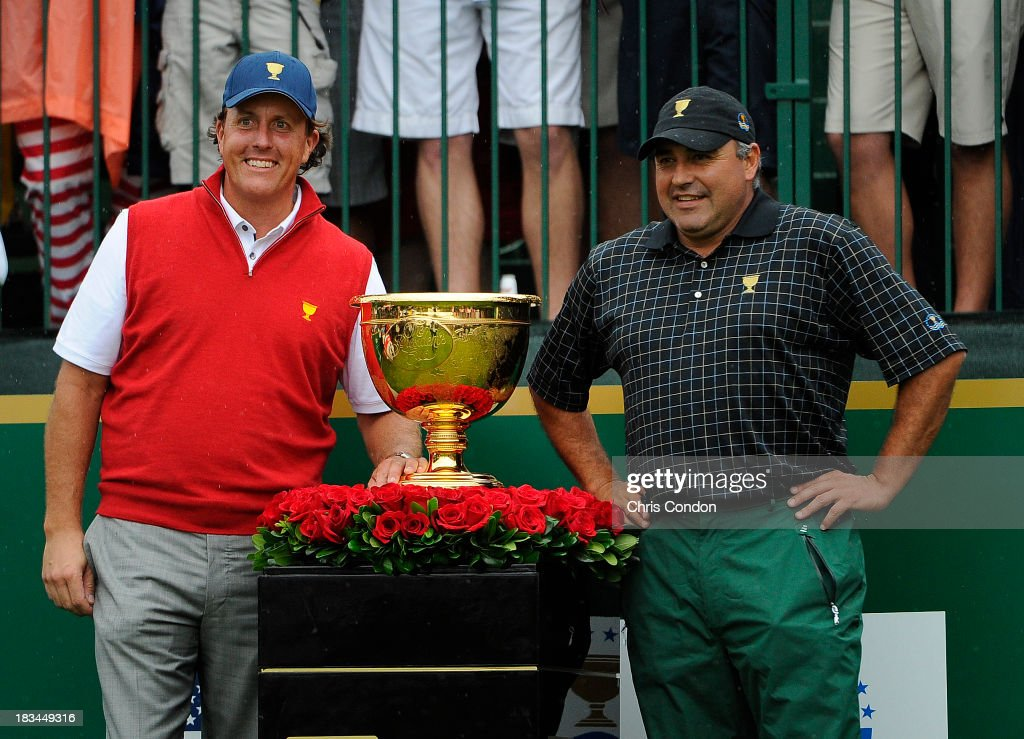 Phil Mickelson of the U.S. Team and Angel Cabrera of the International Team pose with the Presidents Cup trophy at the first tee during the Final Round Singles Matches of The Presidents Cup at the Muirfield Village Golf Club on October 6, 2013 in Dublin, Ohio.
