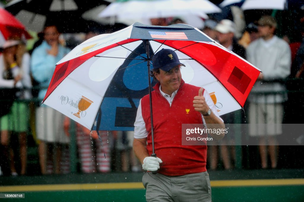 Phil Mickelson of the U.S. Team gives a thumbs-up to the fans on the first hole during the Final Round Singles Matches of The Presidents Cup at the Muirfield Village Golf Club on October 6, 2013 in Dublin, Ohio.