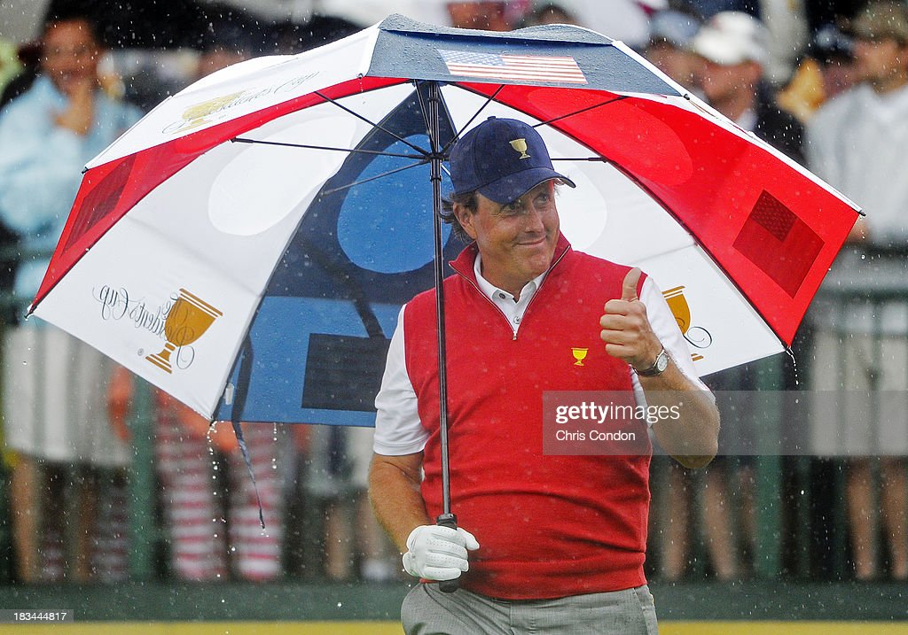 Phil Mickelson of the U.S. Team gives Thumbs Up to fans prior to the start of the Final Round Singles Matches of The Presidents Cup at the Muirfield Village Golf Club on October 6, 2013 in Dublin, Ohio.
