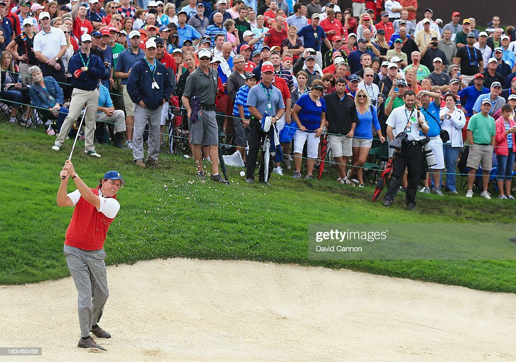 Phil Mickelson of the U.S. Team hits from the sand on the 18th hole during the Day Four Singles Matches at the Muirfield Village Golf Club on October 6, 2013 in Dublin, Ohio.