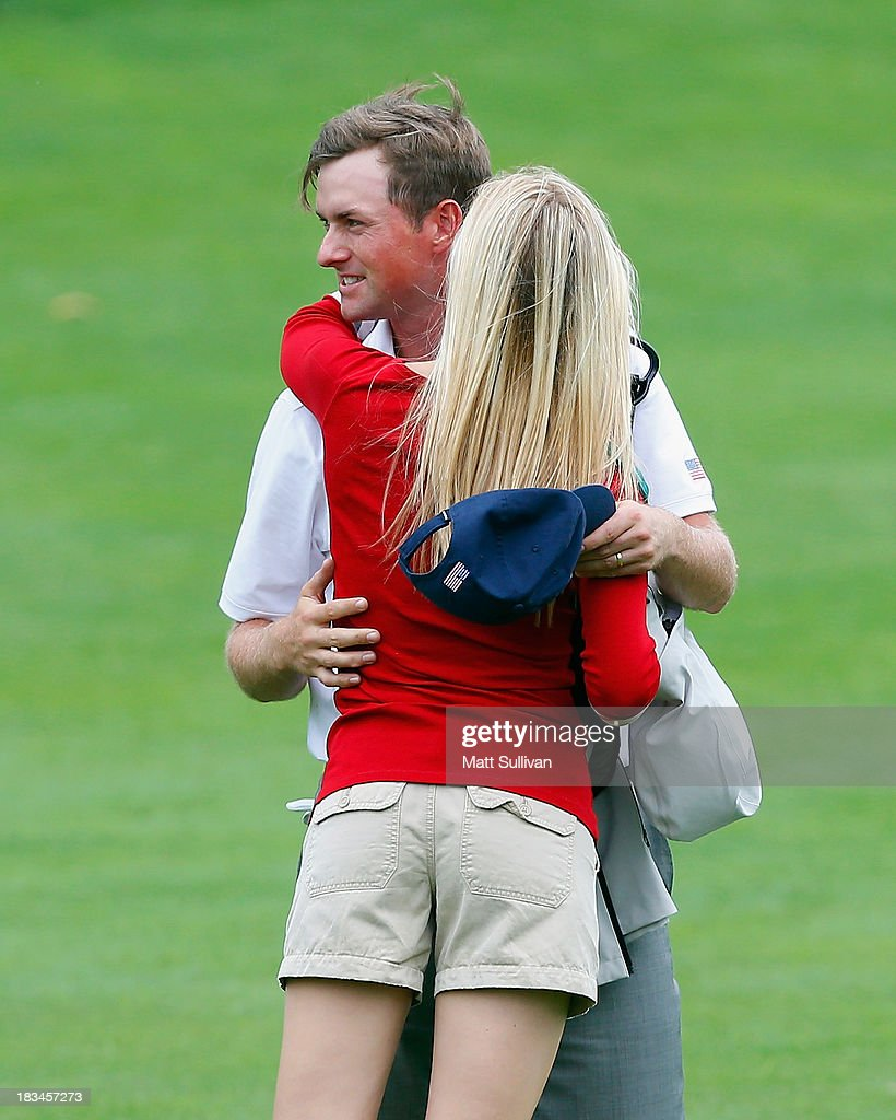 Phil Mickelson of the U.S. Team hugs his wife, Dowd, after the U.S. Team defeated the International Team 18.5 to 15.5 after the Day Four Singles Matches at the Muirfield Village Golf Club on October 6, 2013 in Dublin, Ohio.