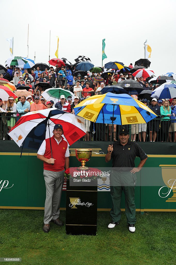Phil Mickelson of the U.S. Team pose for a photo with Angel Cabrera of the International Team on the first hole during the Final Round Singles Matches of The Presidents Cup at the Muirfield Village Golf Club on October 6, 2013 in Dublin, Ohio.