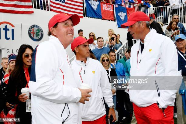 Phil Mickelson of the US Team Rickie Fowler of the US Team and Matt Kuchar of the US Team talk on the first tee during the afternoon fourball matches...