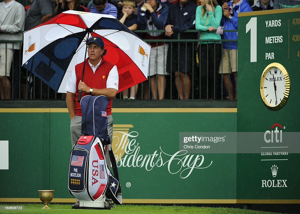 Phil Mickelson of the U.S. Team wait on the first hole during the Final Round Singles Matches of The Presidents Cup at the Muirfield Village Golf Club on October 6, 2013 in Dublin, Ohio.