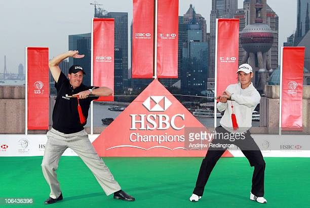 Phil Mickelson of the USA and Martin Kaymer of Germany cross swords during the 2010 WGCHSBC Champions Photocall at The Peninsula hotel on The Bund...