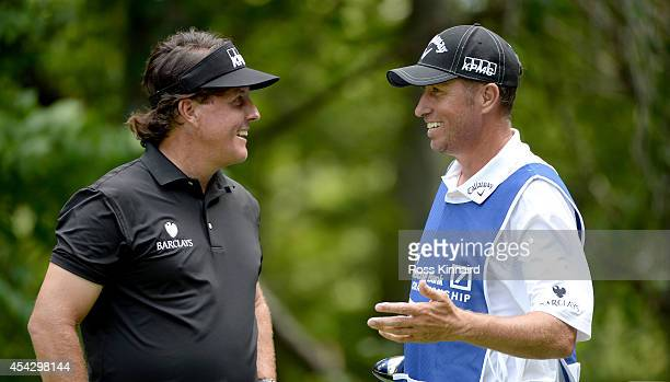 Phil Mickelson of the USA chatting to his caddie Jim 'Bones' Mackay during the proam event prior to the Deutsche Bank Championship at the TPC Boston...