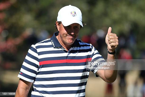 Phil Mickelson of the USA gives a thumbs up on the 14th hole during the Singles Matches for The 39th Ryder Cup at Medinah Country Club on September...