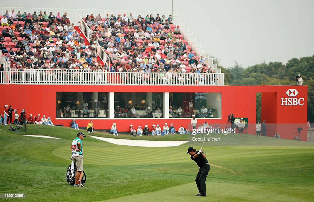 Phil Mickelson of the USA hits a shot on the 18th hole during the third round of the WGCHSBC Champions at the Sheshan International Golf Club on...