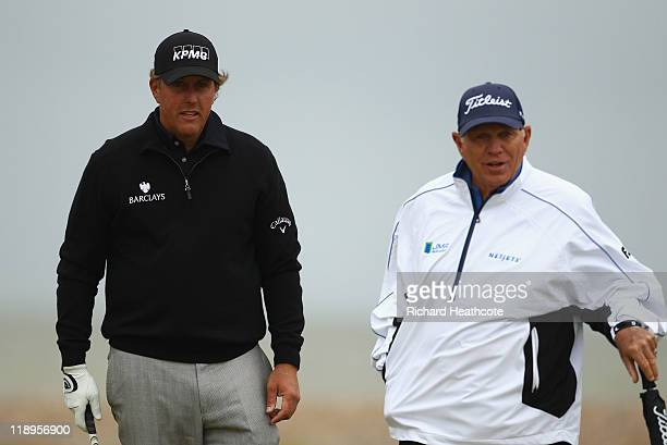 Phil Mickelson of the USA is seen with his coach Butch Harmon during the final practice round during The Open Championship at Royal St George's on...