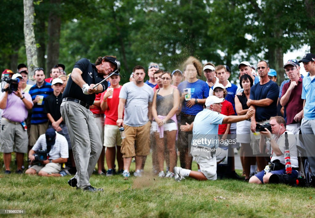 <a gi-track='captionPersonalityLinkClicked' href=/galleries/search?phrase=Phil+Mickelson&family=editorial&specificpeople=157543 ng-click='$event.stopPropagation()'>Phil Mickelson</a> of the USA plays a shot from the rough on the 13th hole during the second round of the Deutsche Bank Championship at TPC Boston on August 31, 2013 in Norton, Massachusetts.