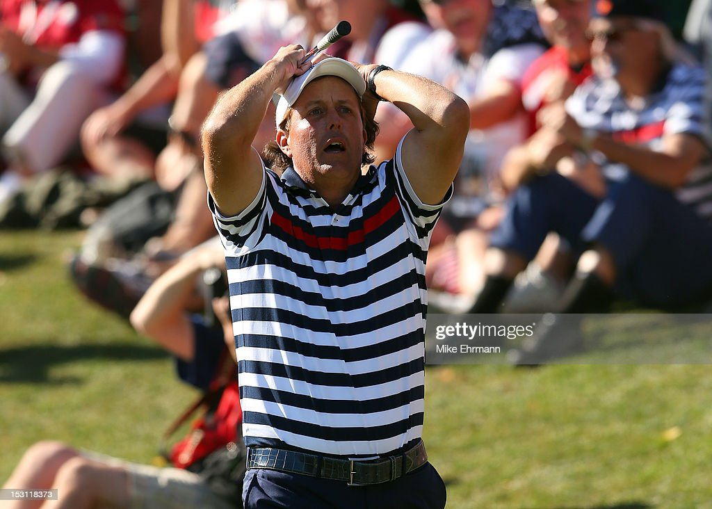 Phil Mickelson of the USA reacts to a shot on the 17th hole during the Singles Matches for The 39th Ryder Cup at Medinah Country Club on September 30, 2012 in Medinah, Illinois.