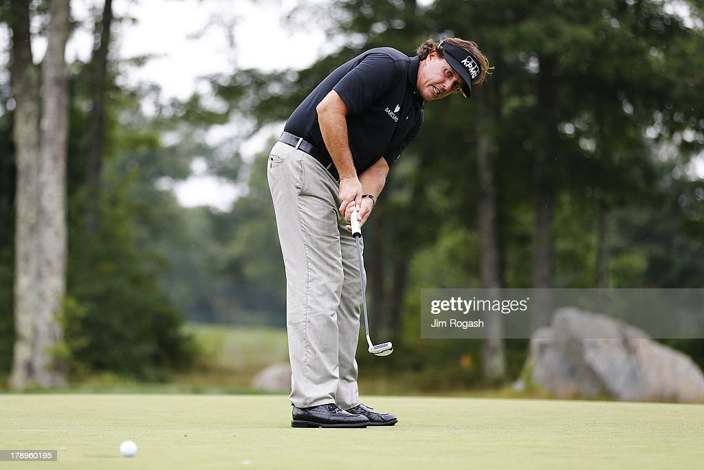 <a gi-track='captionPersonalityLinkClicked' href=/galleries/search?phrase=Phil+Mickelson&family=editorial&specificpeople=157543 ng-click='$event.stopPropagation()'>Phil Mickelson</a> of the USA reacts to his putt on the 15th green during the second round of the Deutsche Bank Championship at TPC Boston on August 31, 2013 in Norton, Massachusetts.