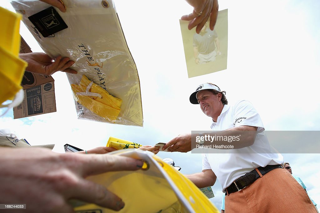 Phil Mickelson of the USA signs autographs for spectators during a practise round for THE PLAYERS Championship at TPC Sawgrass on May 7, 2013 in Ponte Vedra Beach, Florida.