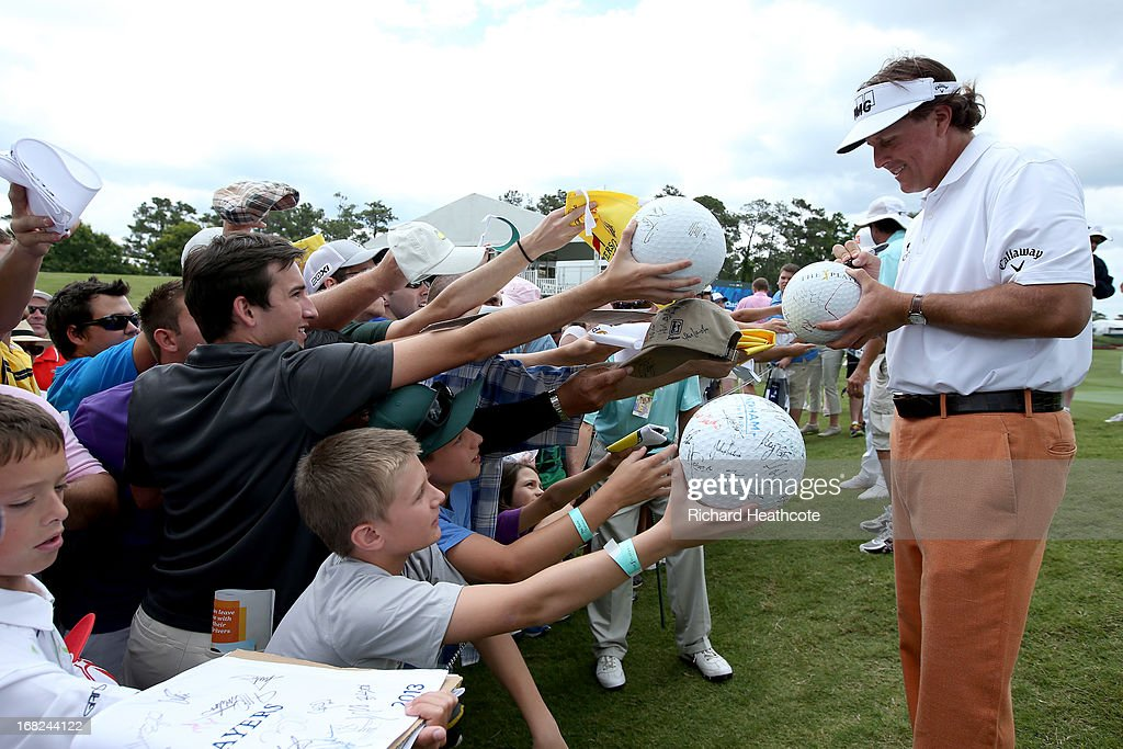 <a gi-track='captionPersonalityLinkClicked' href=/galleries/search?phrase=Phil+Mickelson&family=editorial&specificpeople=157543 ng-click='$event.stopPropagation()'>Phil Mickelson</a> of the USA signs autographs for spectators during a practise round for THE PLAYERS Championship at TPC Sawgrass on May 7, 2013 in Ponte Vedra Beach, Florida.