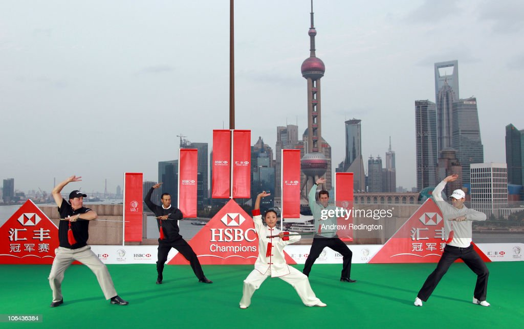 Phil Mickelson of the USA, Tiger Woods of the USA, Lee Westwood of England and Martin Kaymer of Germany receive a Tai Chi lesson with swords during the 2010 WGC-HSBC Champions Photocall at The Peninsula hotel on The Bund, Shanghai on November 2, 2010 in Shanghai, China.