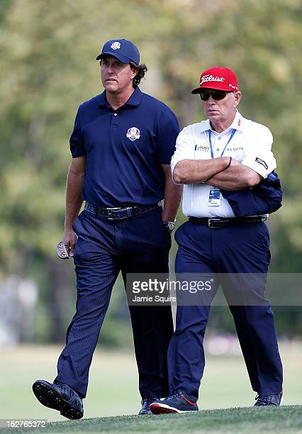 Phil Mickelson of the USA walks with his instructor Butch Harmon during a practice round during the second preview day of The 39th Ryder Cup at...