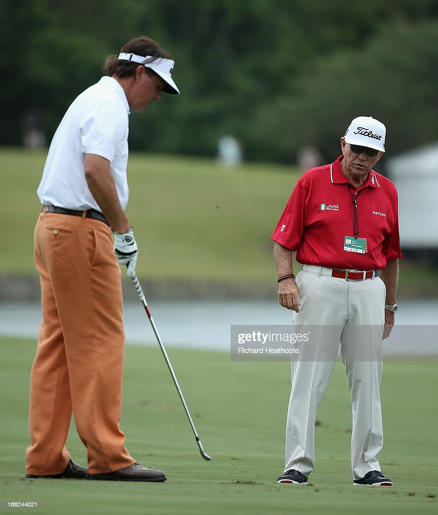 <a gi-track='captionPersonalityLinkClicked' href=/galleries/search?phrase=Phil+Mickelson&family=editorial&specificpeople=157543 ng-click='$event.stopPropagation()'>Phil Mickelson</a> of the USA with his coach <a gi-track='captionPersonalityLinkClicked' href=/galleries/search?phrase=Butch+Harmon&family=editorial&specificpeople=570839 ng-click='$event.stopPropagation()'>Butch Harmon</a> during a practise round for THE PLAYERS Championship at TPC Sawgrass on May 7, 2013 in Ponte Vedra Beach, Florida.