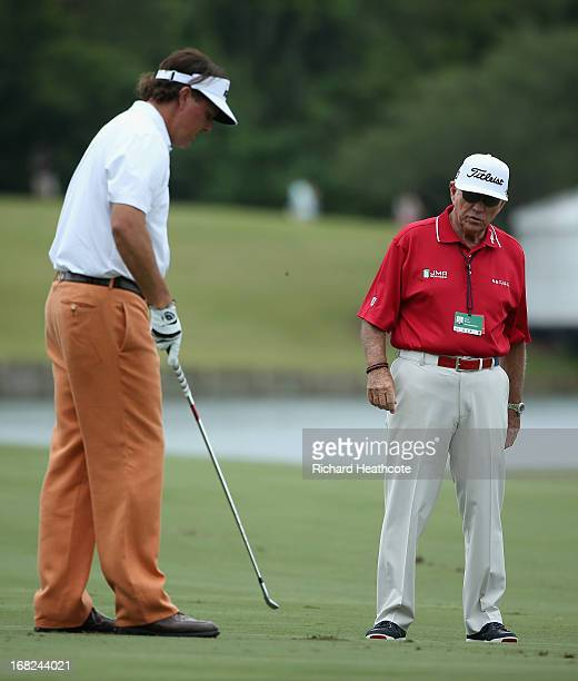 Phil Mickelson of the USA with his coach Butch Harmon during a practise round for THE PLAYERS Championship at TPC Sawgrass on May 7 2013 in Ponte...
