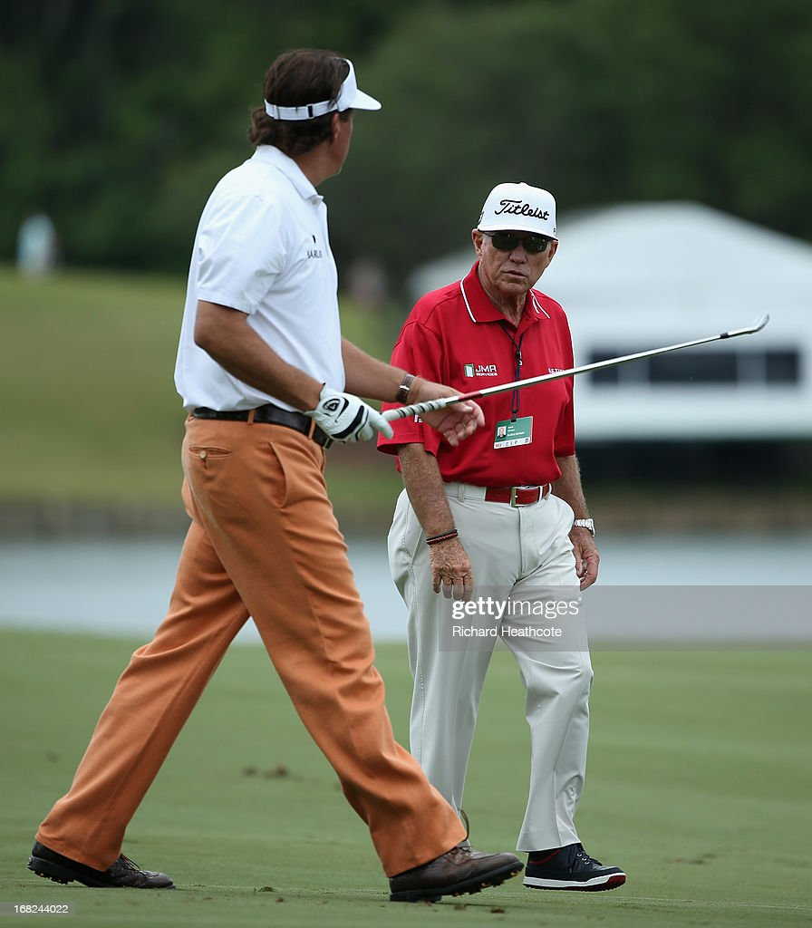 Phil Mickelson of the USA with his coach Butch Harmon during a practise round for THE PLAYERS Championship at TPC Sawgrass on May 7, 2013 in Ponte Vedra Beach, Florida.