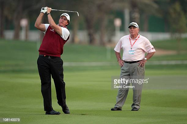 Phil Mickelson of the USA with his coach Butch Harmon of the USA during the proam as a preview for the 2011 Abu Dhabi HSBC Golf Championship to be...
