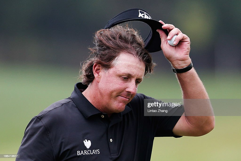 <a gi-track='captionPersonalityLinkClicked' href=/galleries/search?phrase=Phil+Mickelson&family=editorial&specificpeople=157543 ng-click='$event.stopPropagation()'>Phil Mickelson</a> of United States reacts after during his first round of the WGC-HSBC Champions at the Sheshan International Golf Club on October 31, 2013 in Shanghai, China.