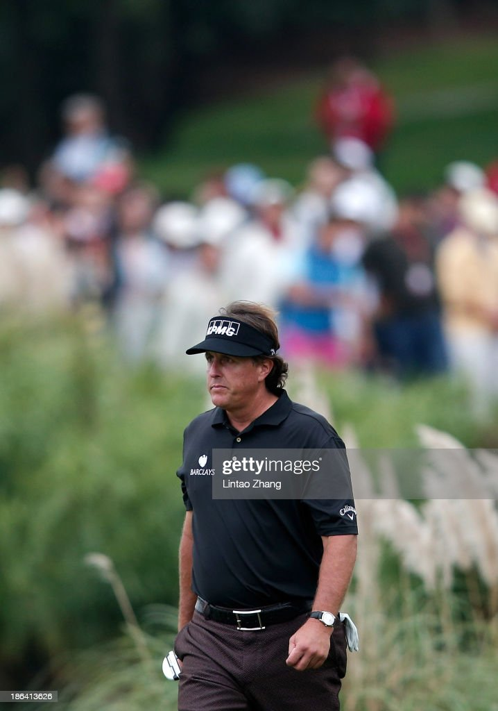 <a gi-track='captionPersonalityLinkClicked' href=/galleries/search?phrase=Phil+Mickelson&family=editorial&specificpeople=157543 ng-click='$event.stopPropagation()'>Phil Mickelson</a> of United States walks a hole during the first round of the WGC-HSBC Champions at the Sheshan International Golf Club on October 31, 2013 in Shanghai, China.
