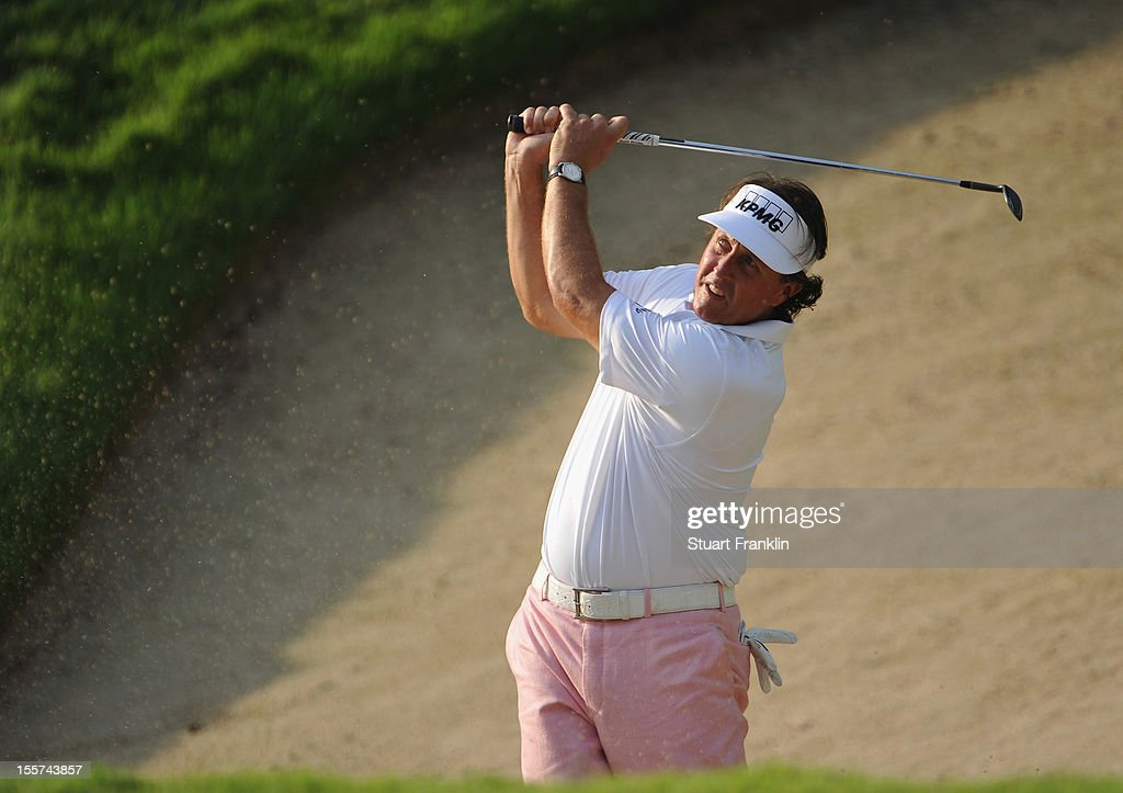 Phil Mickelson of USA plays a bunker shot during the first round of the Barclays Singapore Open at the Sentosa Golf Club on November 8, 2012 in Singapore.