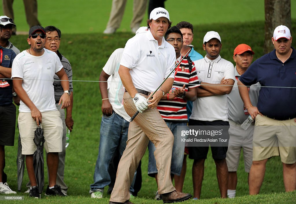 Phil Mickelson of USA plays a shot during round two of the CIMB Classic at Kuala Lumpur Golf & Country Club on October 25, 2013 in Kuala Lumpur, Malaysia.