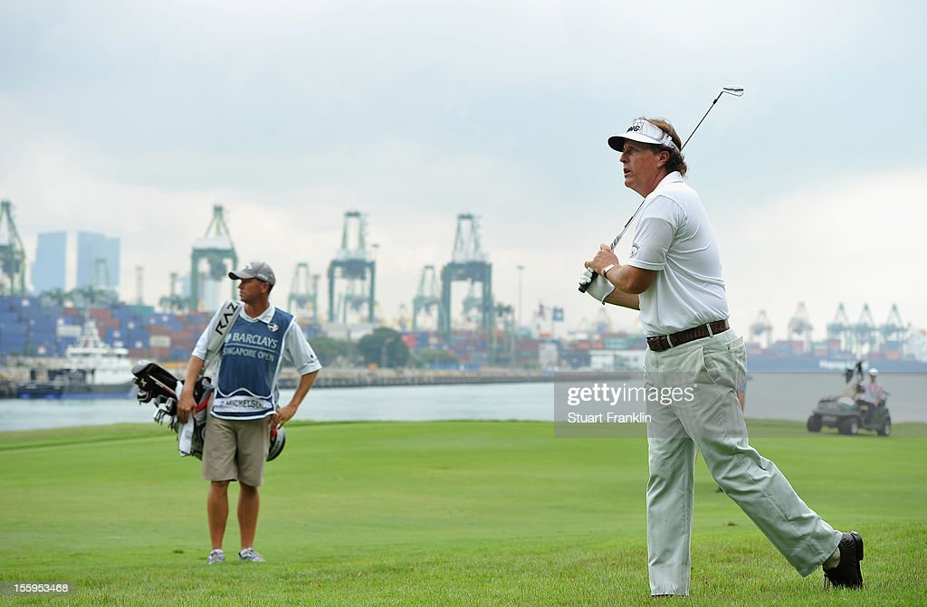 Phil Mickelson of USA plays a shot on the seventh hole during the resumption of the rain delayed second round of the Barclays Singapore Open at the Sentosa Golf Club on November 10, 2012 in Singapore.
