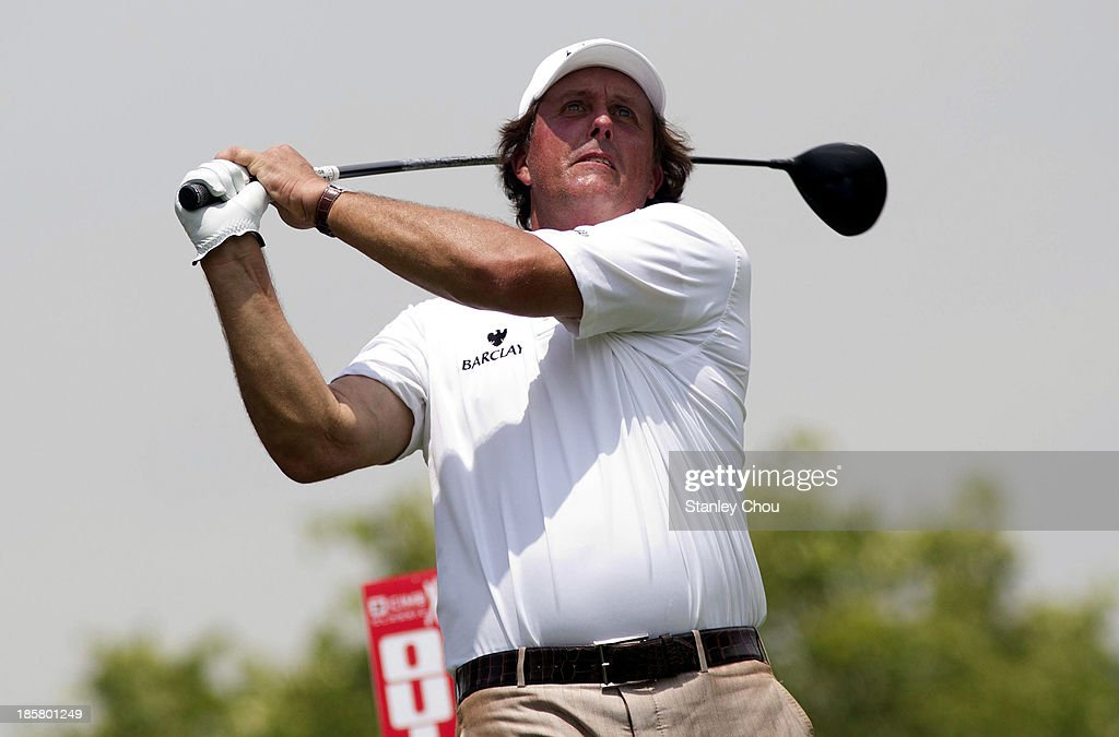 Phil Mickelson of USA plays a tee shot on the 2nd hole during round two of the CIMB Classic at Kuala Lumpur Golf & Country Club on October 25, 2013 in Kuala Lumpur, Malaysia.