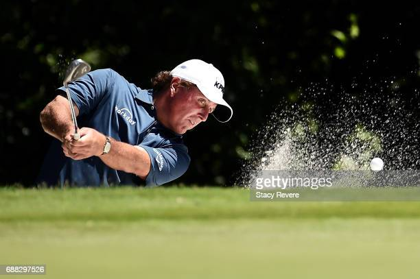 Phil Mickelson plays a shot from a bunker on the fifth hole during Round One of the DEAN DELUCA Invitational at Colonial Country Club on May 25 2017...