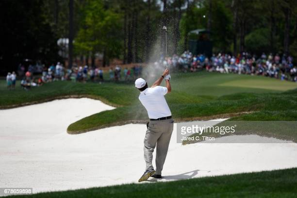 Phil Mickelson plays a shot from a bunker on the third hole during round one of the Wells Fargo Championship at Eagle Point Golf Club on May 4 2017...