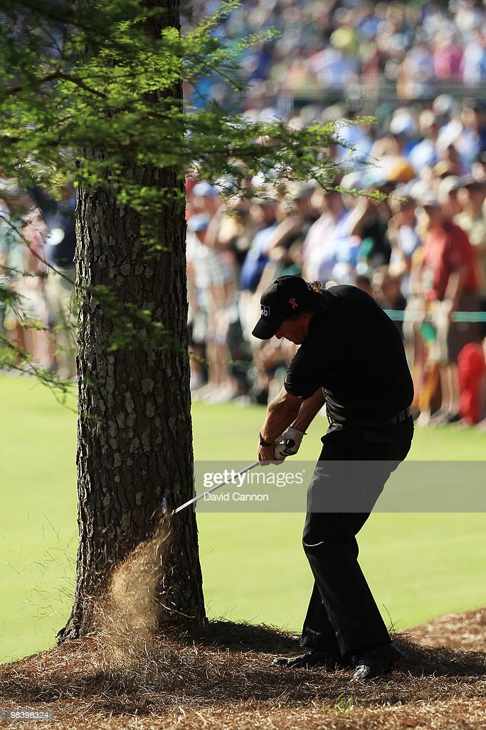 Phil Mickelson plays a shot from the pine needles on the 13th hole during the final round of the 2010 Masters Tournament at Augusta National Golf Club on April 11, 2010 in Augusta, Georgia.