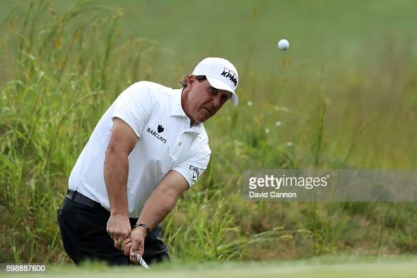 Phil Mickelson plays a shot on the 14th hole during the second round of the Deutsche Bank Championship at TPC Boston on September 3 2016 in Norton...