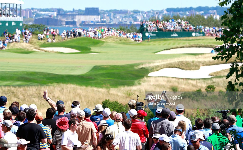 Phil Mickelson plays a shot on the 16th hole during the final round of The Barclays at Liberty National Golf Club on August 25 2013 in Jersey City...