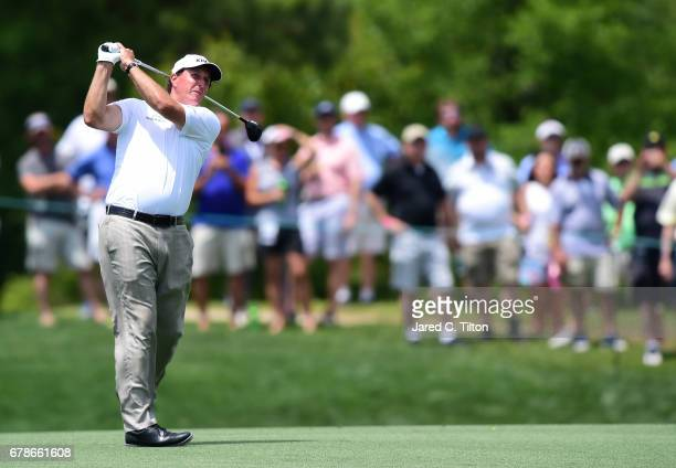 Phil Mickelson plays a shot on the fourth hole during round one of the Wells Fargo Championship at Eagle Point Golf Club on May 4 2017 in Wilmington...