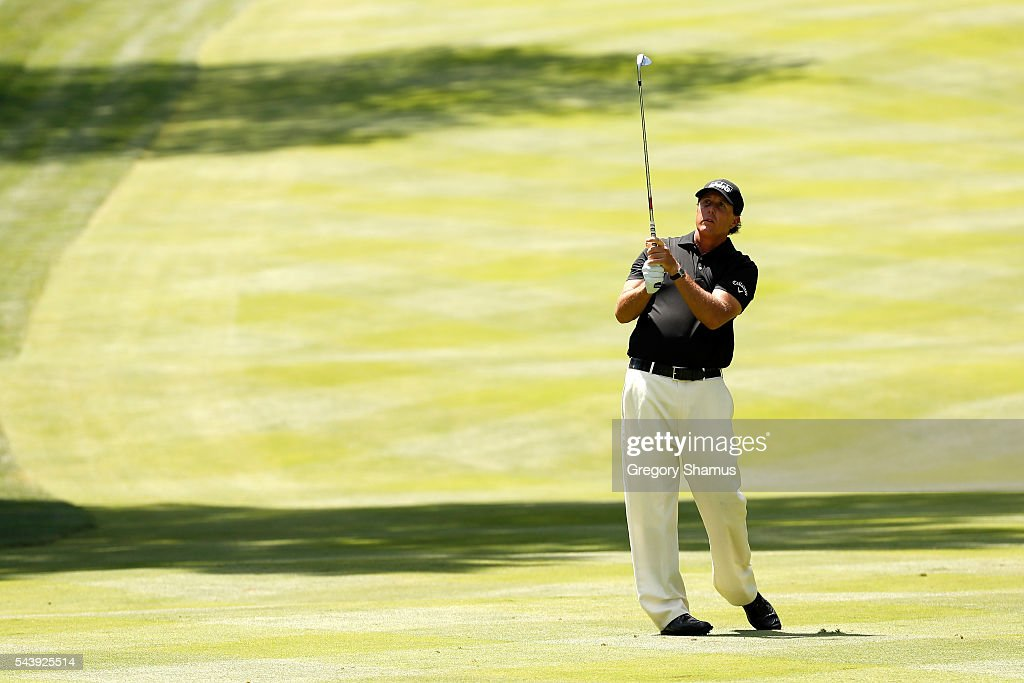 <a gi-track='captionPersonalityLinkClicked' href=/galleries/search?phrase=Phil+Mickelson&family=editorial&specificpeople=157543 ng-click='$event.stopPropagation()'>Phil Mickelson</a> plays a shot on the third fairway during the first round of the World Golf Championships - Bridgestone Invitational at Firestone Country Club South Course on June 30, 2016 in Akron, Ohio.
