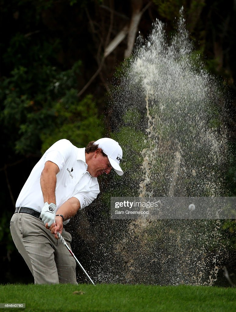 Phil Mickelson plays his shot on the sixth hole out of the water during the first round of The Honda Classic at PGA National Resort & Spa - Champion Course on February 26, 2015 in Palm Beach Gardens, Florida.
