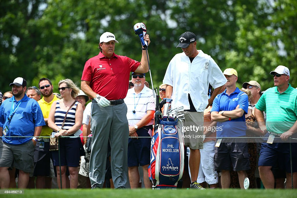 Phil Mickelson pulls a club from his bag on the first hole during the first round of the Memorial Tournament presented by Nationwide Insurance at Muirfield Village Golf Club on May 29, 2014 in Dublin, Ohio.