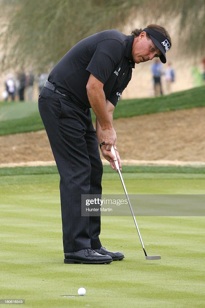 Phil Mickelson putts for birdie on the 12th hole during the final round of the Waste Management Phoenix Open at TPC Scottsdale on February 3, 2013 in Scottsdale, Arizona.